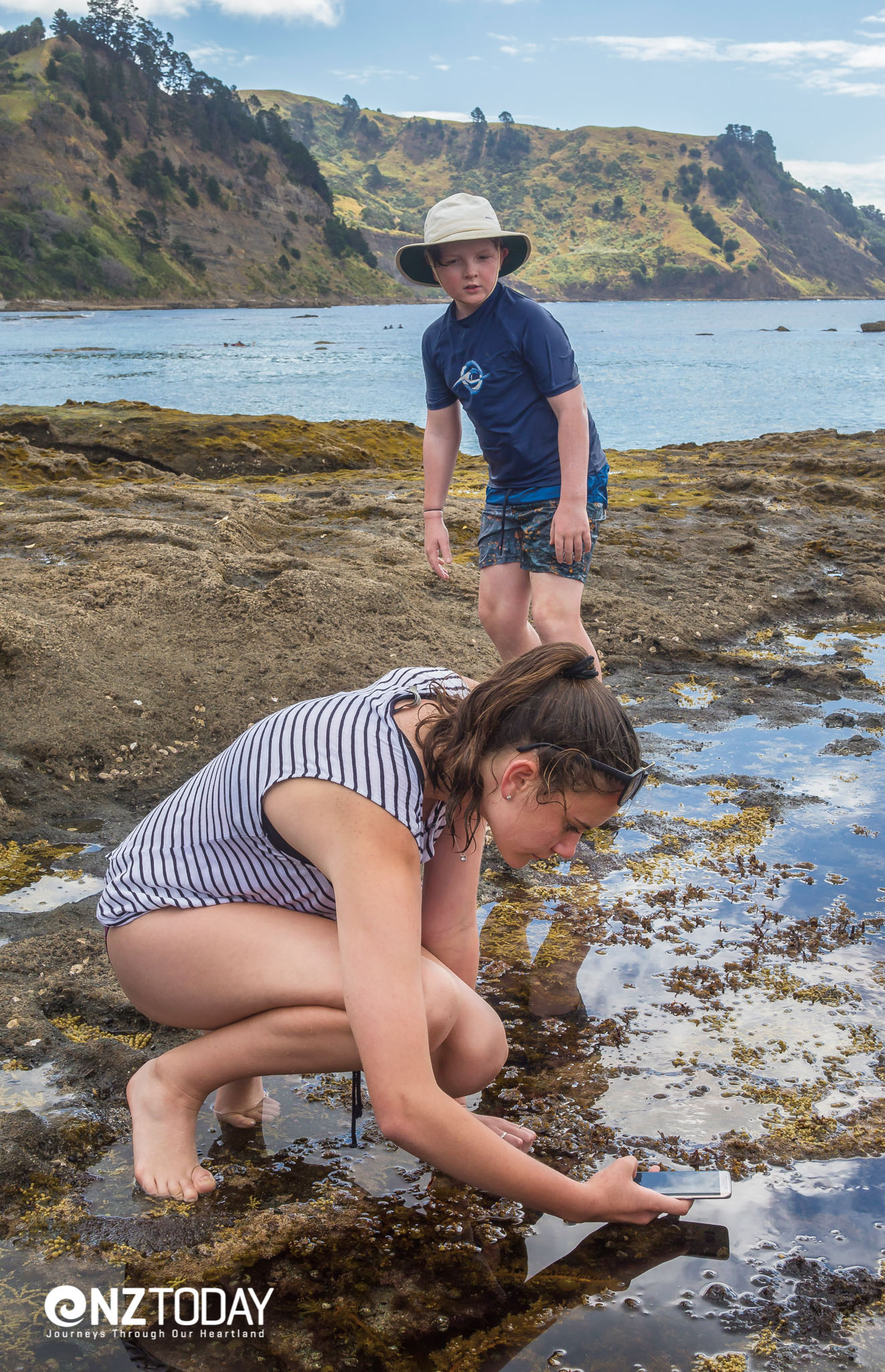 Madison Clifton of Matakana snaps a photo of a tide pool
