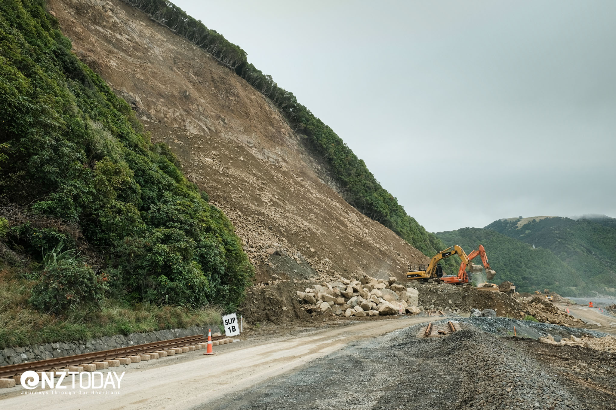 'Slip 1 revisited' is a good illustration of how the rock has been cleared and the slip stabilised. The highway is being rebuilt at this point, closer to the beach