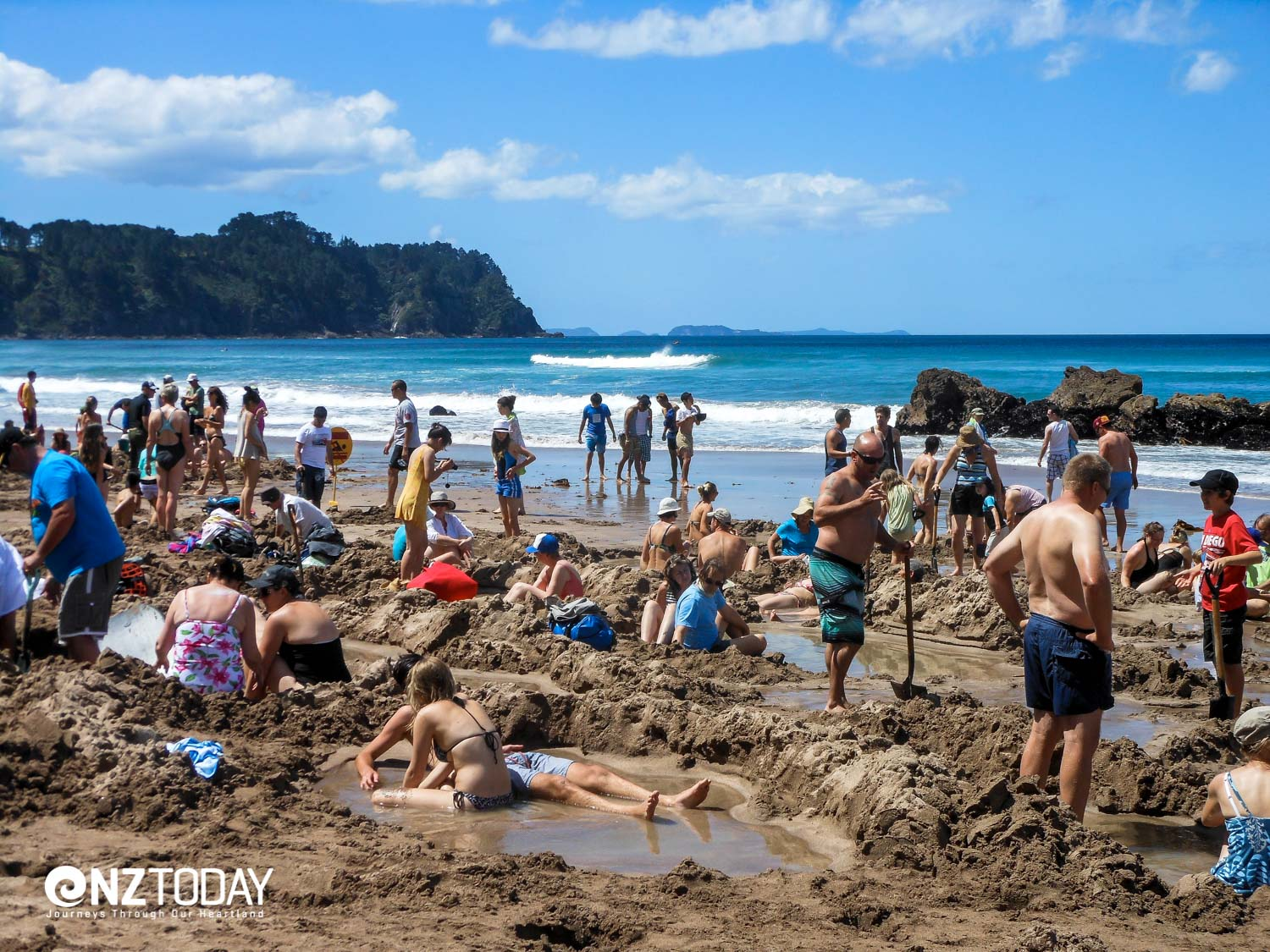 A busy scene at Hot Water Beach
