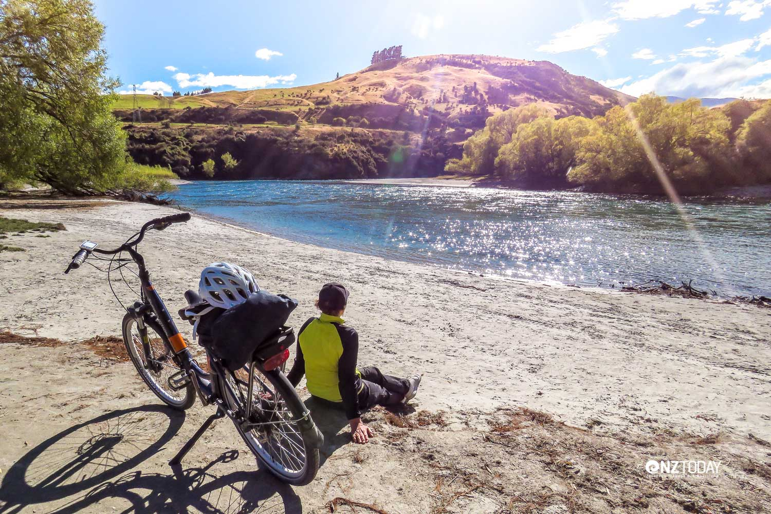 Justine takes a break beside the sparkling Kawarau River