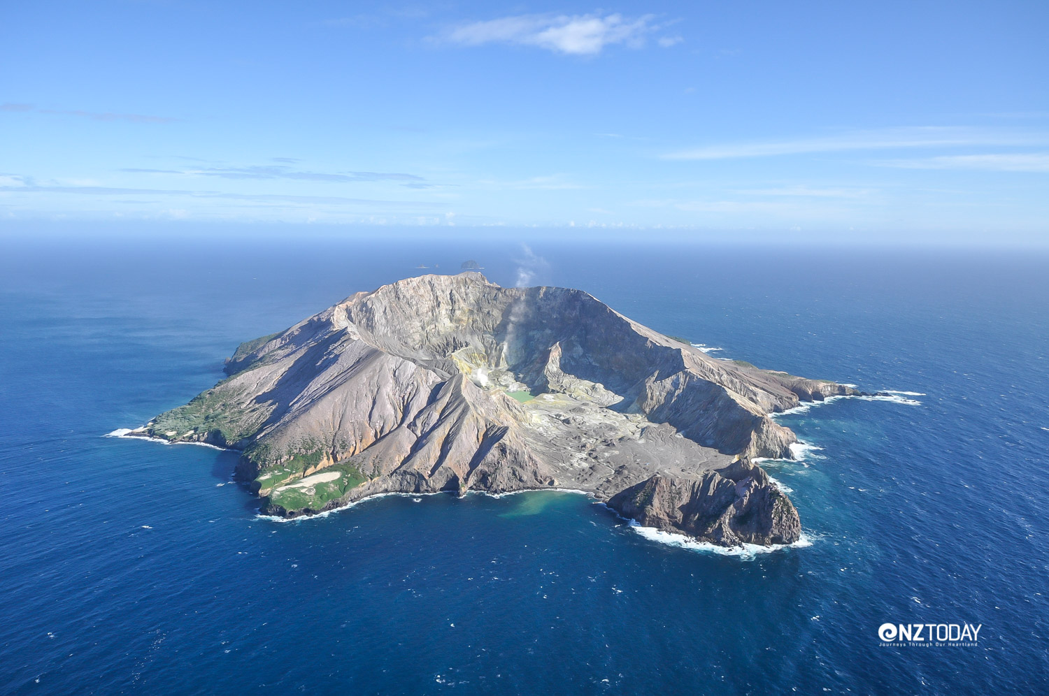 Flying in affords a clear view of the collapsed volcano crater that has become the landing site for both boats and helicopters; as well as the site of historical sulphur mine buildings and equipment