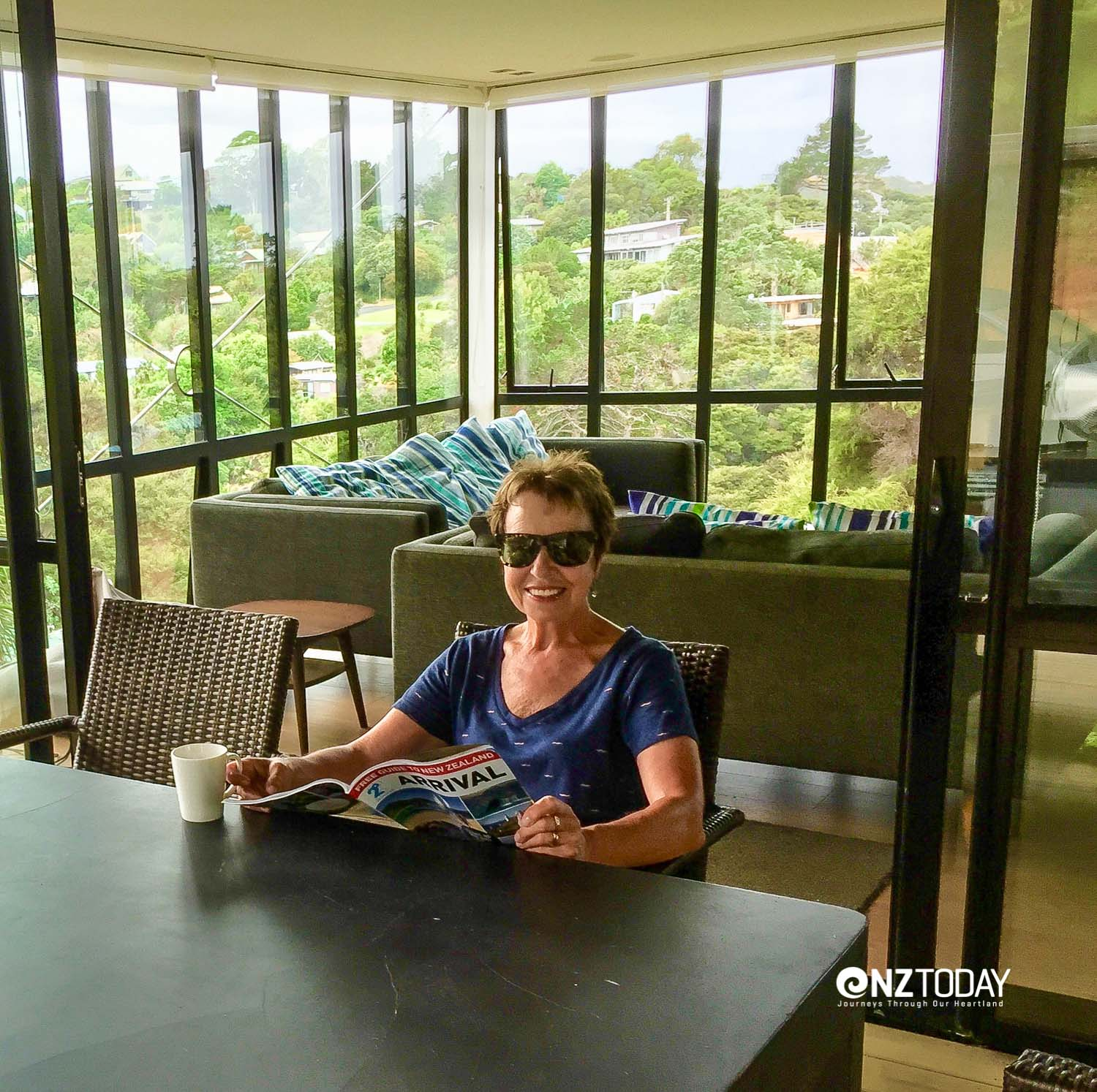 Justine relaxing with a cuppa and a magazine at Palm Beach Treehouse