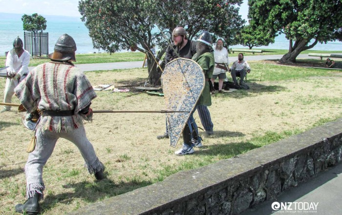 Participants dressed up as soldiers from the middle ages can be seen fighting mock battles on the waterfront during the summer